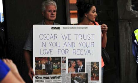 Oscar Pistorius fans show their support for the athlete, who is accused of the murder of Reeva Steenkamp. Photograph: Gallo Images/Getty Images