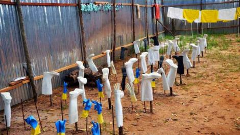 Ebola protective clothing being dried after cleaning with regular water. Soon, Holy Water might be used for protective laundry.