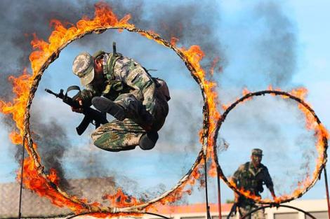 Soldiers jumping through hoops