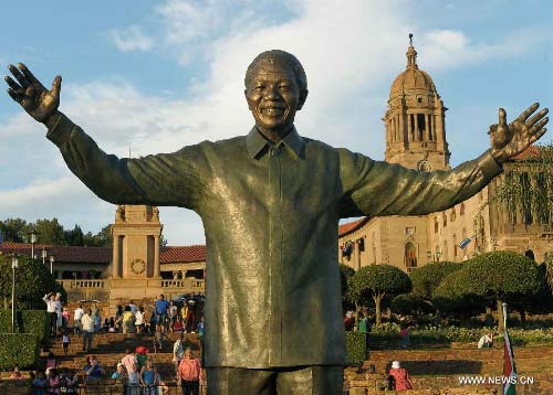 Protesters gather around the offending Mandela statue.